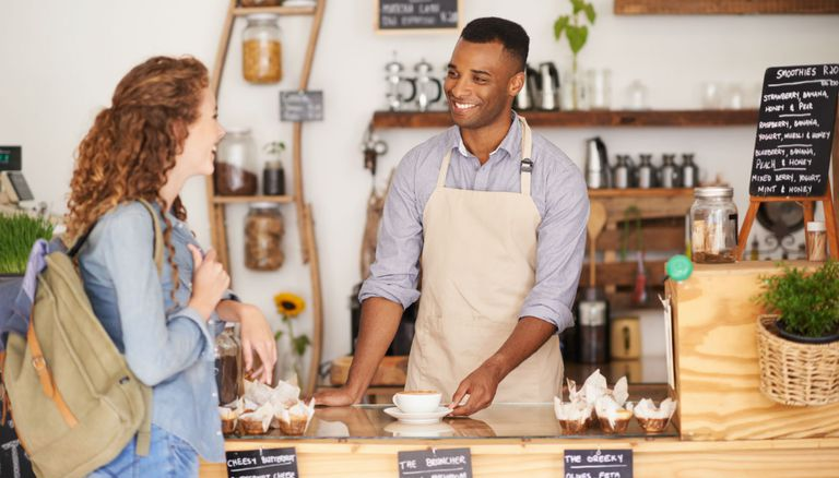 Retail clerk serving customer