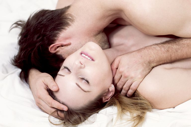 Couple in bed in a moment of intimacy, when trying to conceive it's important to use fertility friendly lubricants