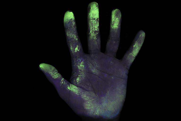 UV light Showing Bacteria on Hand