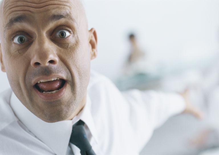 panicked businessman pointing