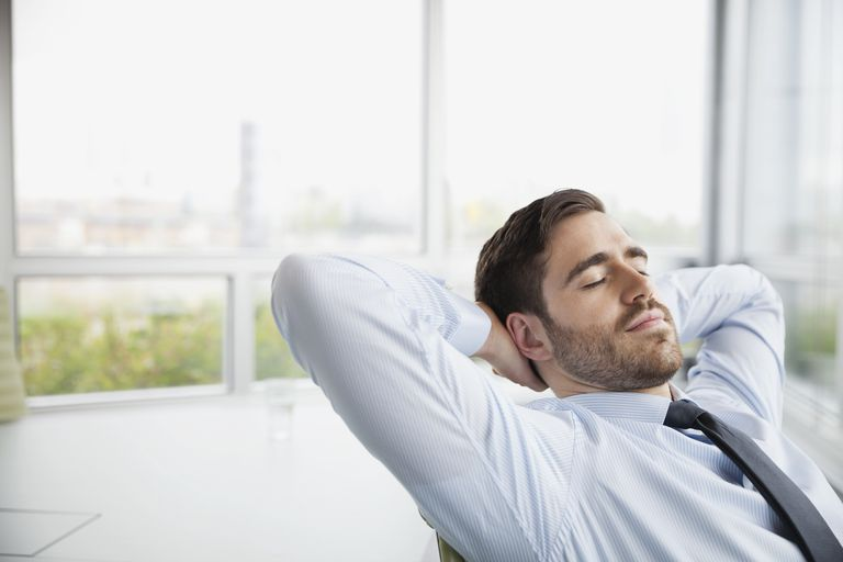 Businessman relaxing with eyes closed