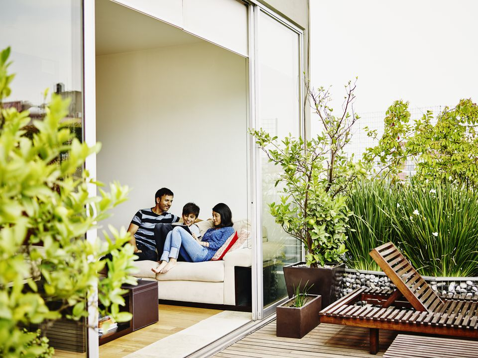 Family looking out onto their plant-adorned patio.