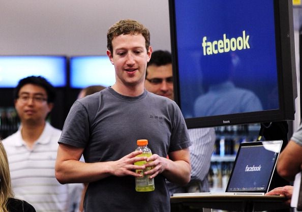 Facebook CEO Mark Zuckerberg prepares to speak at a news conference at Facebook headquarters