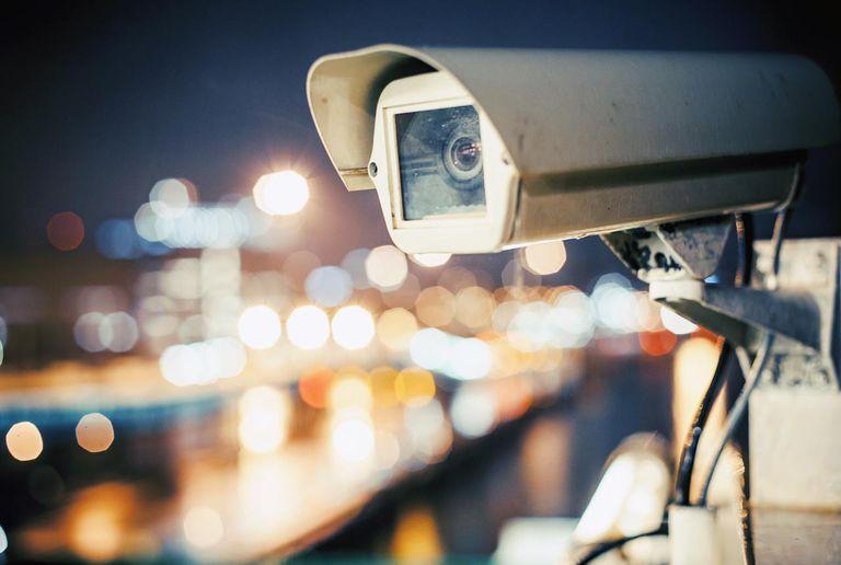 Security camera, city lights background