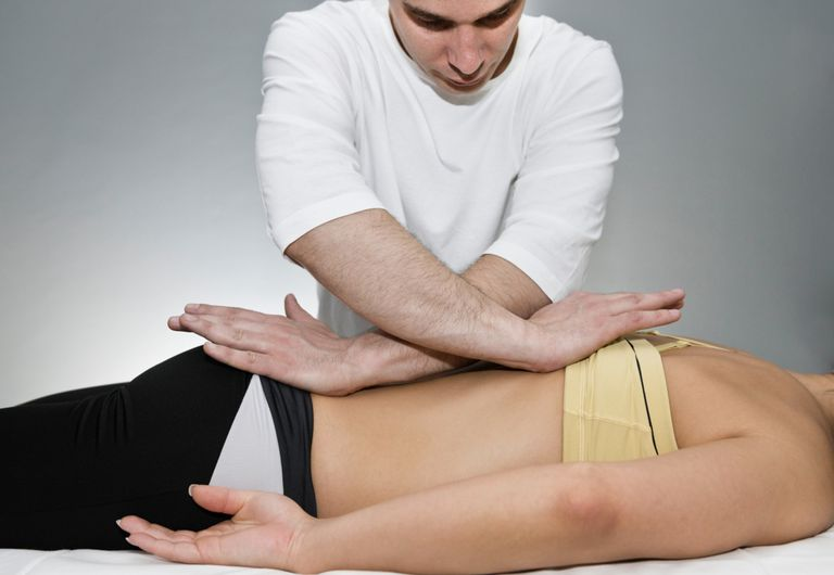 Photo of a chiropractor decompressing a woman's spine.