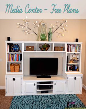 Picture of a white entertainment center and TV
