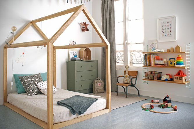 A house-framed floor bed in a Montessori-Inspired Toddler Room