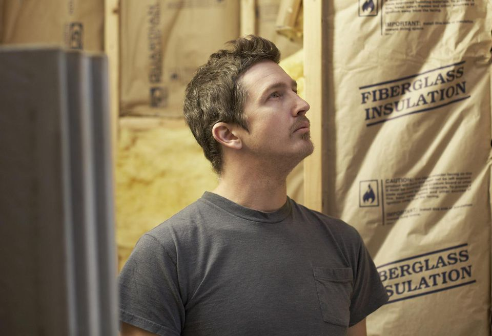 Man looking at construction insulation