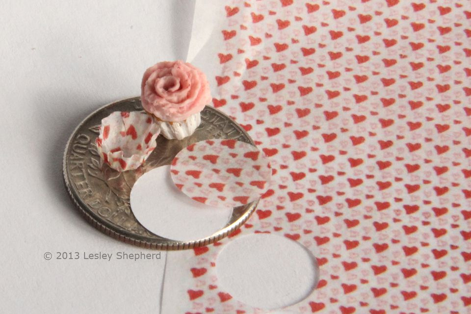 Tissue printed with tiny hearts used to make baking cups in dolls house miniature scale.