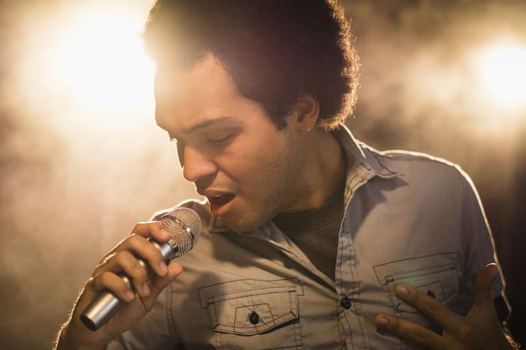 Mixed race singer performing on stage