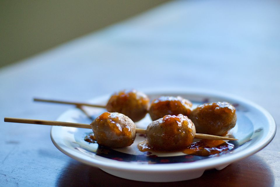 Close-Up Of Meatballs In Toothpicks On Table