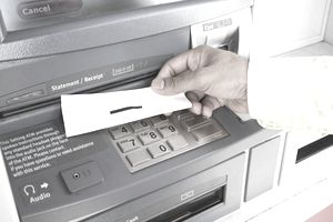 Person at ATM with receipt