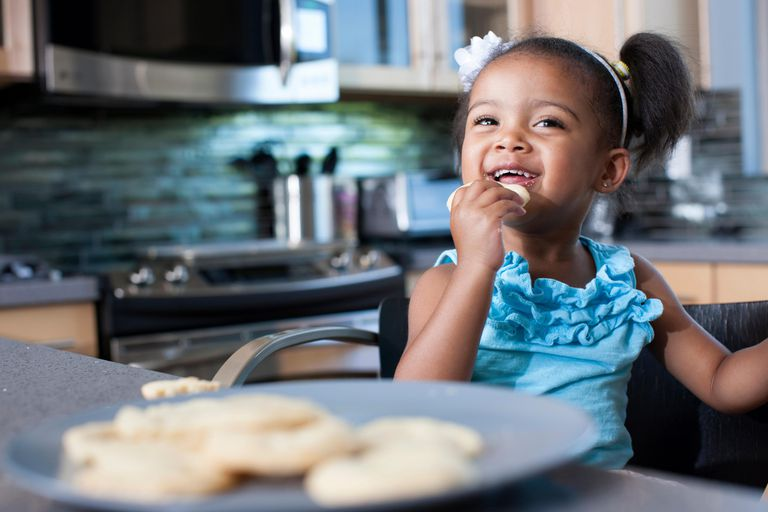 Little girl eating a cookie