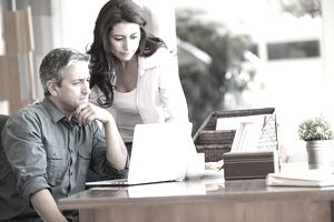 man and woman looking at laptop screen