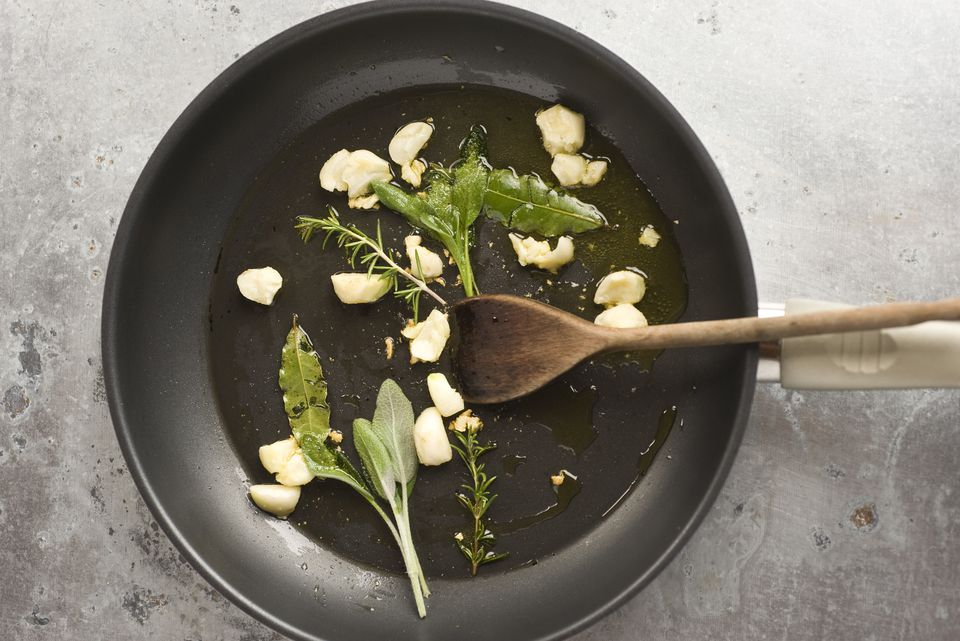 garlic and herbs in pan