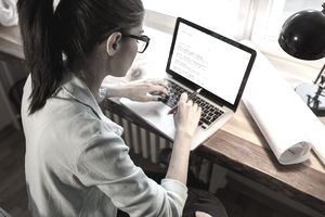 Woman learning new skills on laptop