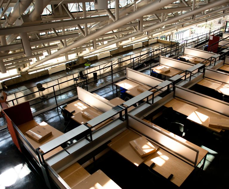 Photo of cubicle-like studio spaces, empty, awaiting new architecture students at Harvard