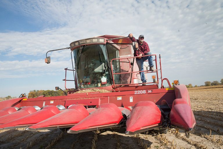 Iowa farmer standing on his harvester