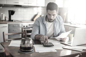 Man dealing with bills
