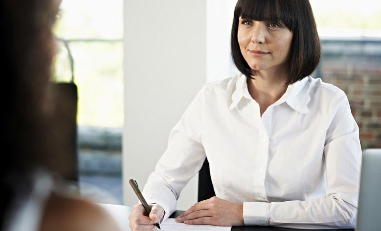 Businesswoman interviewing candidate