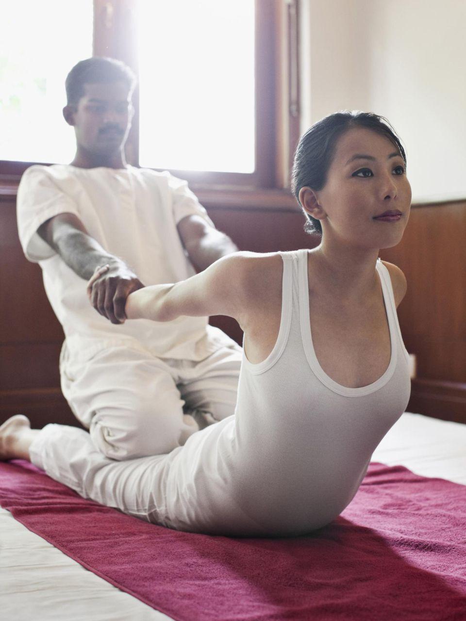 Woman Receiving Thai Massage.
