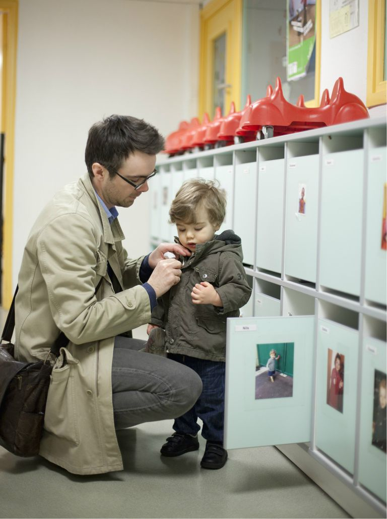 Father dropping toddler son off at daycare