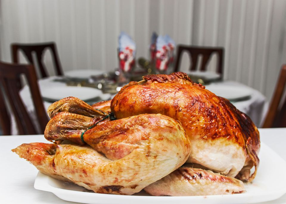 Close-Up Of Roast Turkey Served In Tray On Table At Restaurant