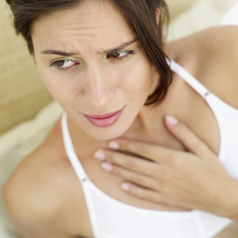 Woman concerned about feeling a lump in her throat.