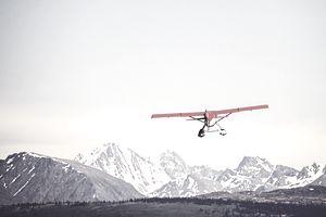 Red Float Plane Against Blue Mountains - Alaska