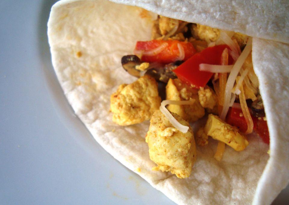 A vegetarian breakfast burrito with tofu
