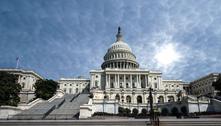 Low Angle View Of Capitol Building Against Cloudy Sky