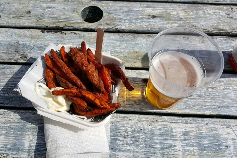 High Angle View Of Fried Sweet Potatoes and Beer On Table