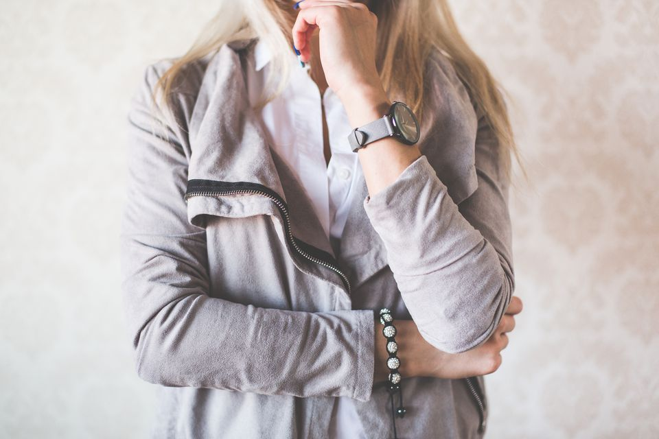 woman wearing white button down shirt