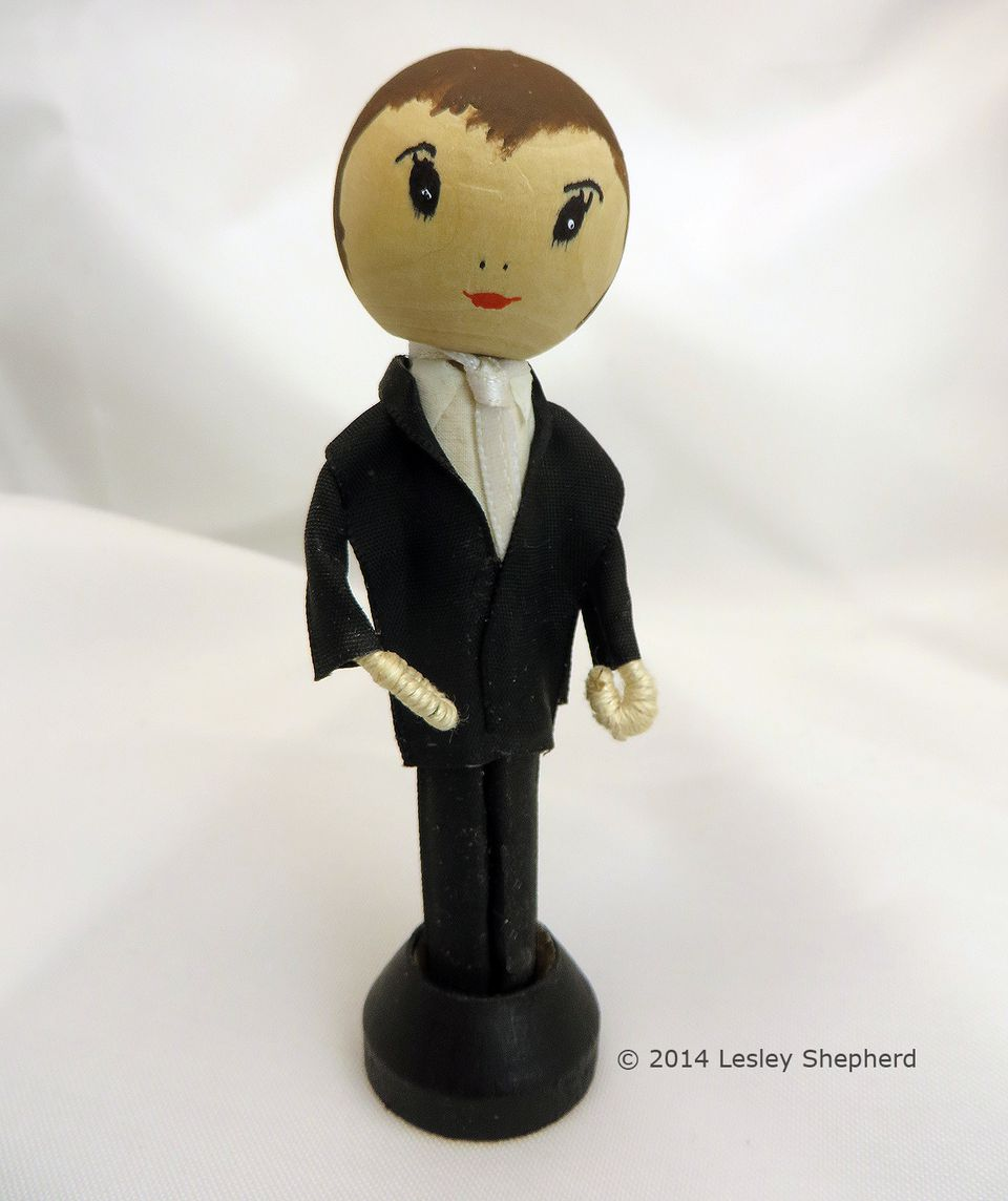 Clothespeg groom doll in a black tuxedo made from satin ribbon.