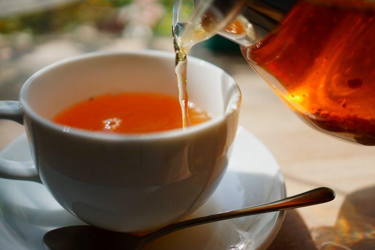 Close-Up Of Teapot Pouring Tea