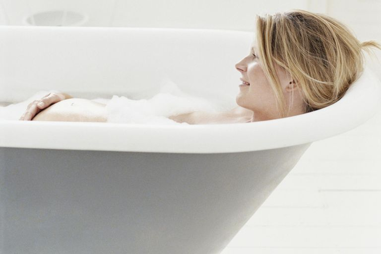 Pregnant Woman Lying in Bath.