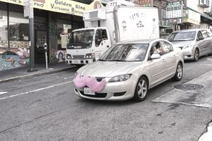 Picture of a Lyft car in San Francisco's Chinatown district.