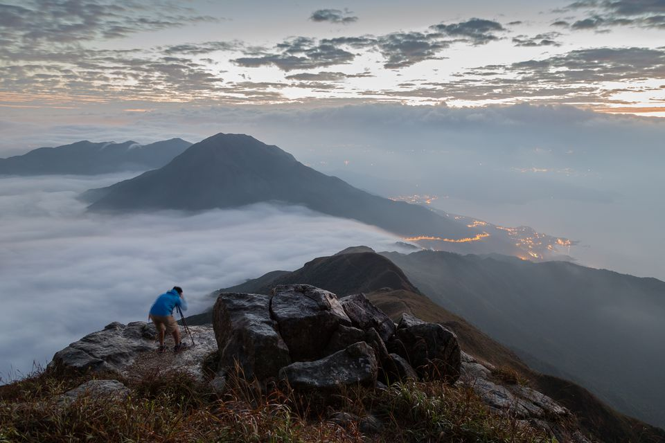 Man photographing at the Lantau Peak at dawn