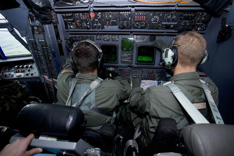 Airmen at work in a MC-130H Combat Talon II.