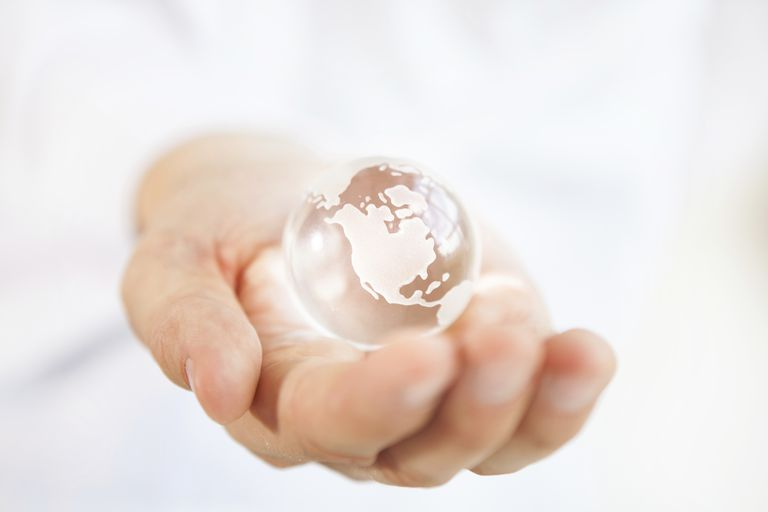 Shiny Glass Globe in Hand