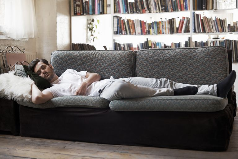 man sleeping on couch on his right side, sleeping on left side better for heartburn