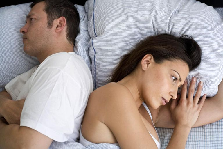 Young couple at home in bed