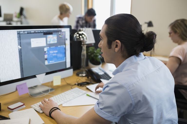 Graphic designer working at computer in office