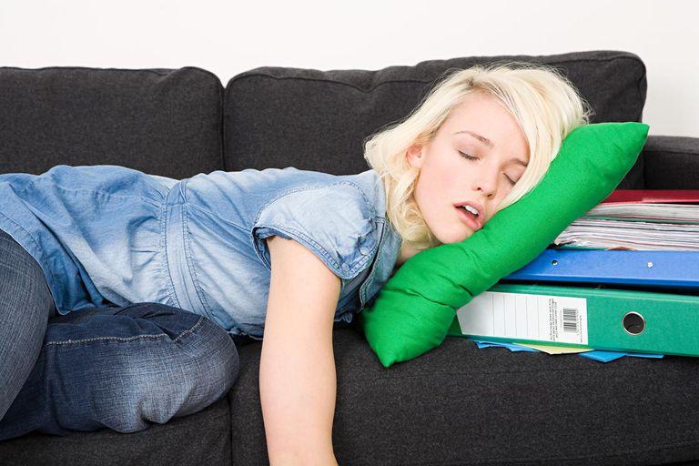 Female student sleeping on sofa