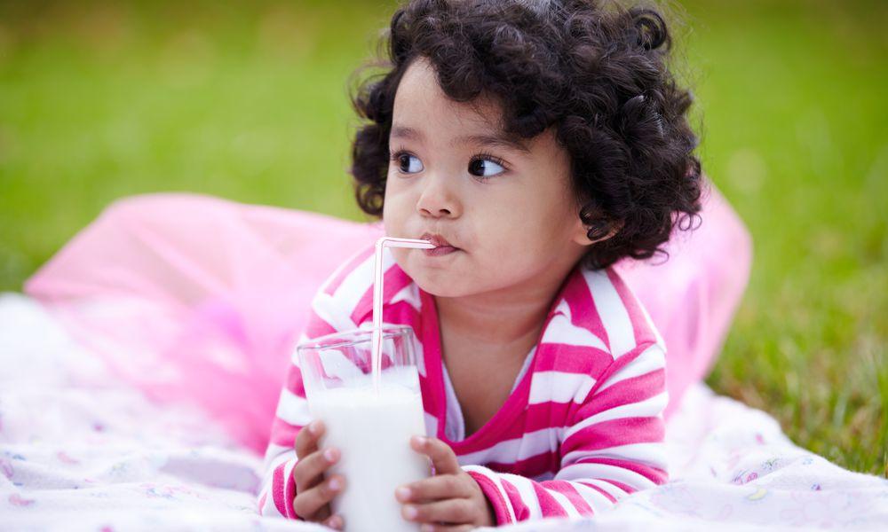 Toddler drinking milk through a straw