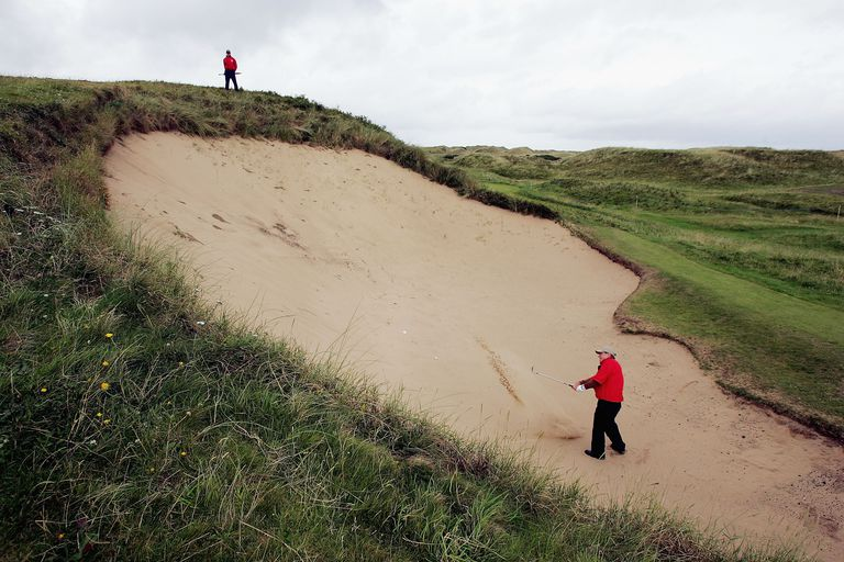 Graham Marsh plays out of the Big Bertha bunker at Royal Portrush during a Senior British Open