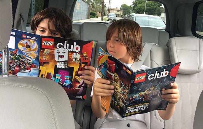 Two boys reading the free LEGO Club magazine.