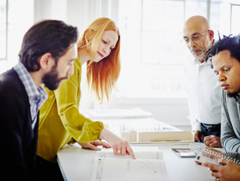 Businesswoman presenting project to coworkers