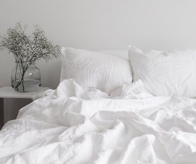 feng shui white color bed and bedroom flowers