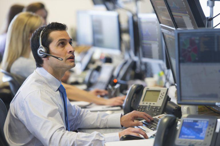A stock trader at a computer
